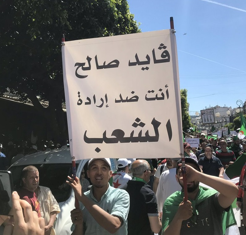"Friday's protest. Placard says ""General Salah, you are against the will of the people."" Photo via <a href=""https://twitter.com/HamdiBaala"">@HamdiBaala</a>"