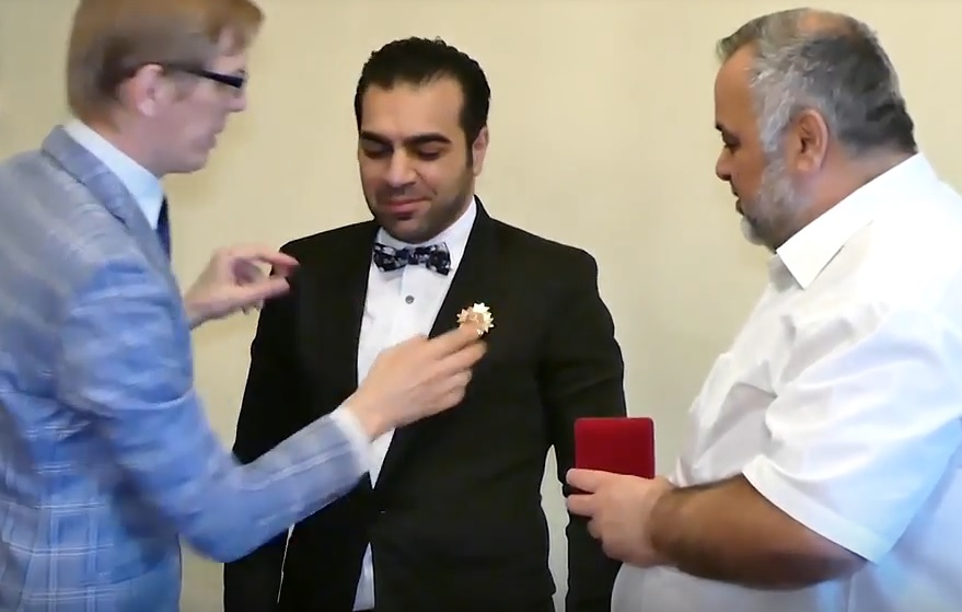 Anas Bao receives his medal in Moscow