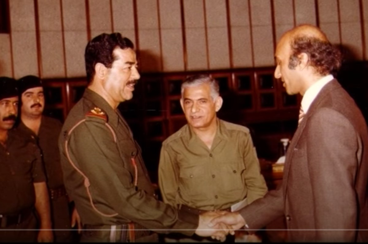 Dr Bashir shaking hands with Saddam Hussein