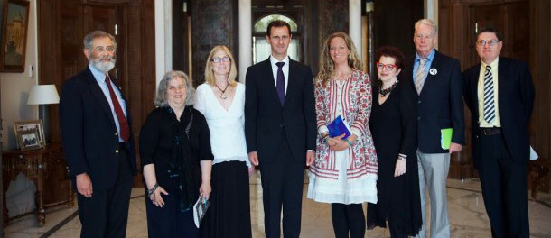 Beeley (fourth from right) with President Assad in 2016. She described it as her proudest moment.
