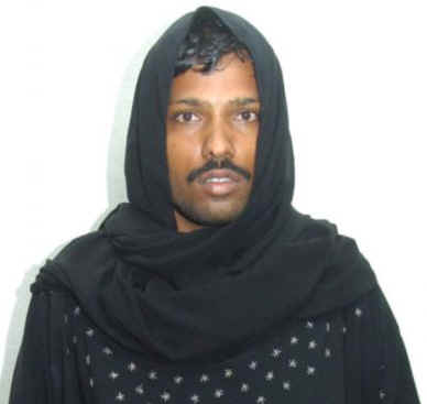 Photo circulated by police of an Indian man arrested for cross-dressing in Sharjah last month