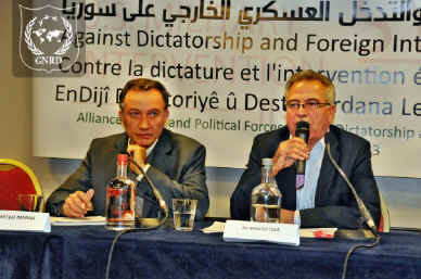 "Haytham Manna (left) and Khaled Issa of the PYD at GNRD's conference ""Against Dictatorship and Foreign Intervention in Syria"" in 2013."