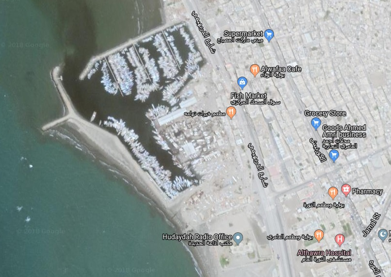 Satellite view showing the fishing port in Hodeidah with the fish market slightly to its right. A second bomb hit the entrance to al-Thawra hospital (bottom right-hand corner on the map).