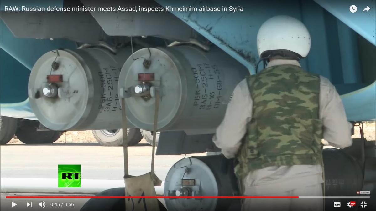 Screen grab from RT's report showing a warplane in Syria fitted with incendiary weapons