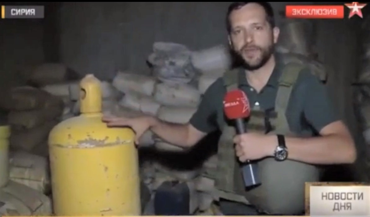 "A reporter from Zvezda, the Russian defence ministry's TV channel, with the ""rebel cylinder"". Video <a href=""http://players.brightcove.net/2540076170001/o9klXdNXL_default/index.html?videoId=5772185829001"">here</a>."