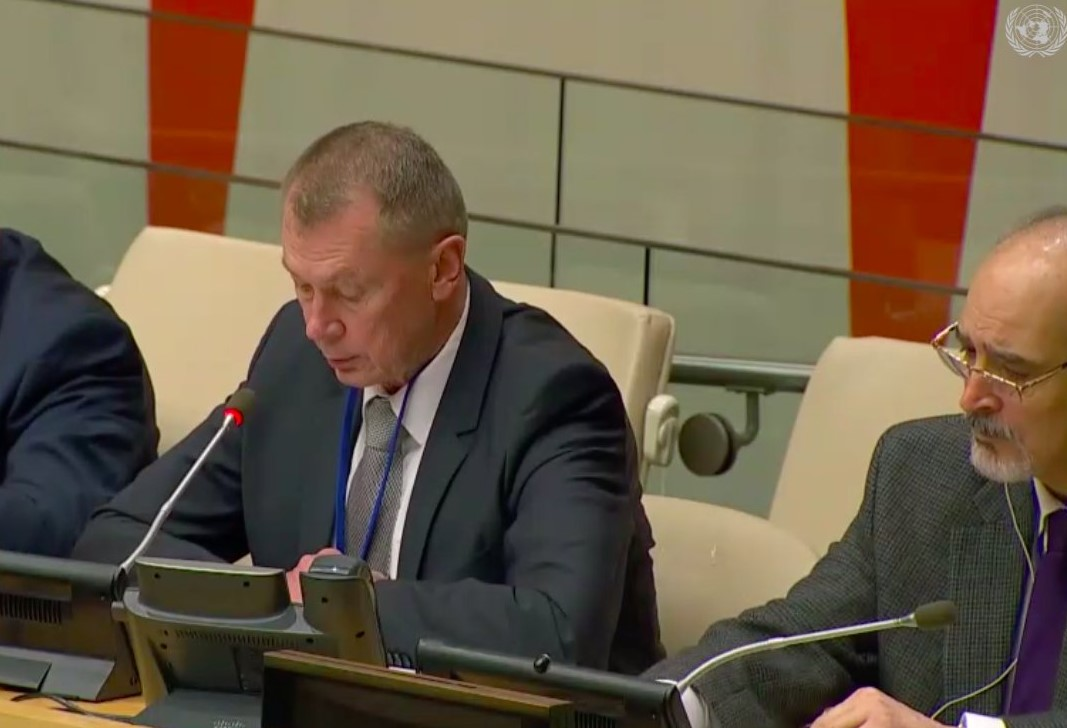 Russian representative Alexander Shulgin speaking at the UN on Monday, flanked by Syrian representative Bashar Jaafari (right)