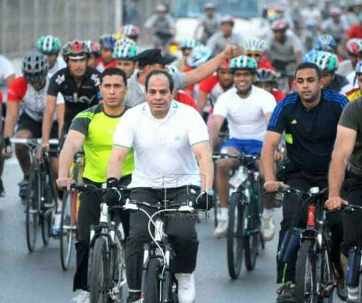 Saving on fuel, President Sisi takes to a bike