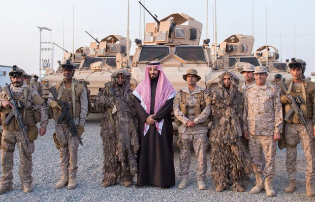 Prince Muhammad Bin Salman, chief architect of the Saudi intervention in Yemen, pictured with members of  the armed forces in February this year. Photo: SPA